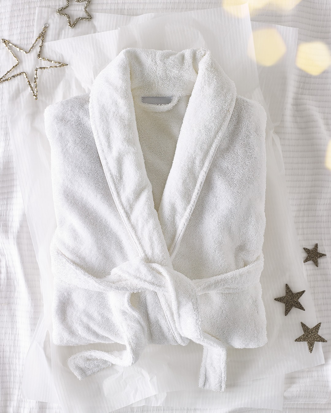 The White Company sells beautiful home items, not only linen, but also candles, and fluffy robes to wear to bed.